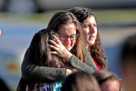 """February 14, 2018 - Parkland, Florida USA: Students are released from a lockdown outside of Stoneman Douglas High School in Parkland after reports of an active shooter Wednesday, Feb. 14, 2018.A shooting at a high school in Parkland, Florida, involved """"at least 14 victims"""" and many were feared dead. The suspect identified as Nicolas Cruz, a former student, is in custody. Waiting for word from students at Coral Springs Drive and the Sawgrass Expressway just south of the campus of Marjorie Stonemason Douglas High School in Coral Springs where a shooting occurred on Wednesday, Feb. 14, 2018  (John McCall/South Florida Sun Sentinel/POLARIS)"""